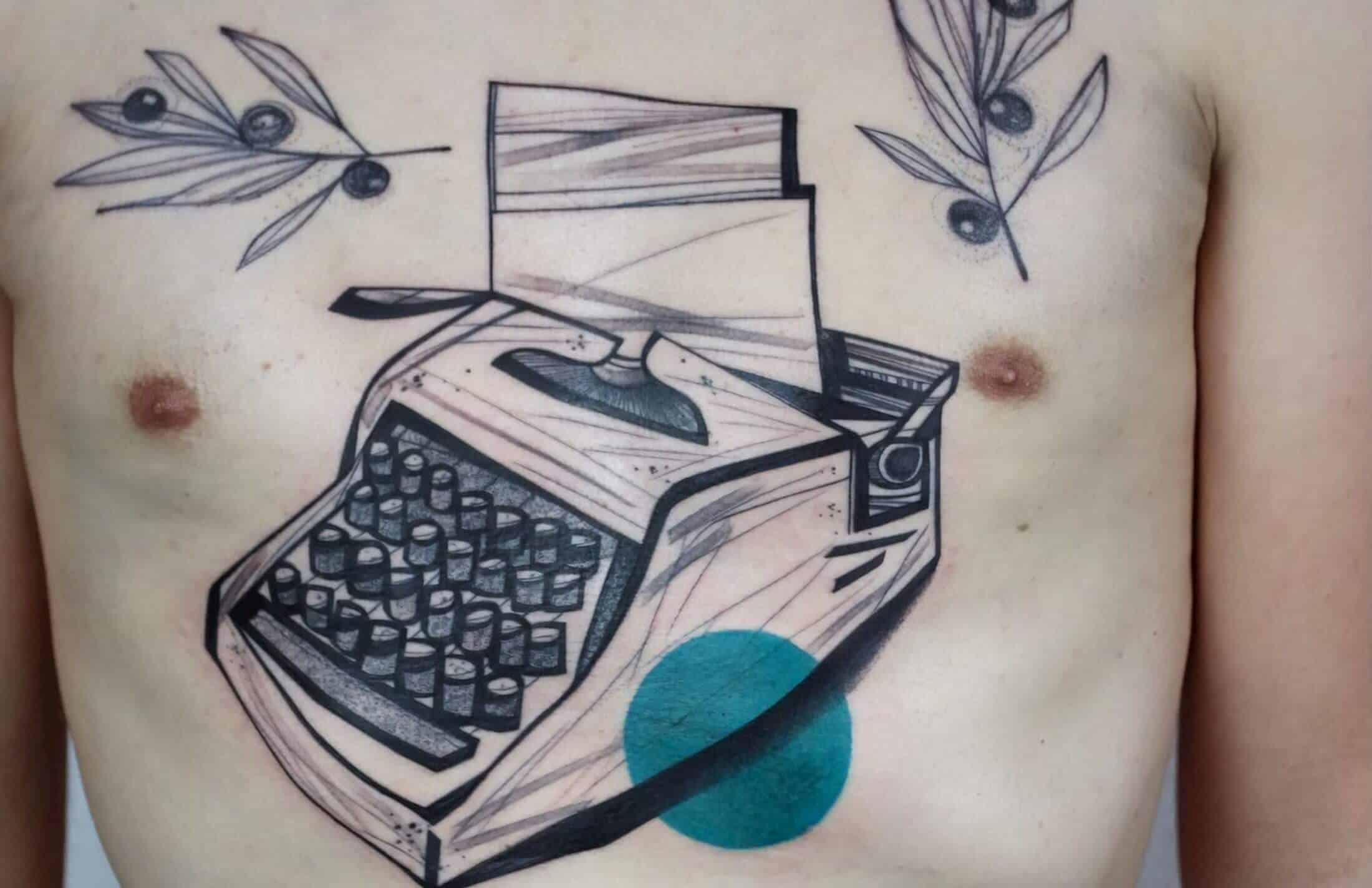 illustrative tattoo by chest.