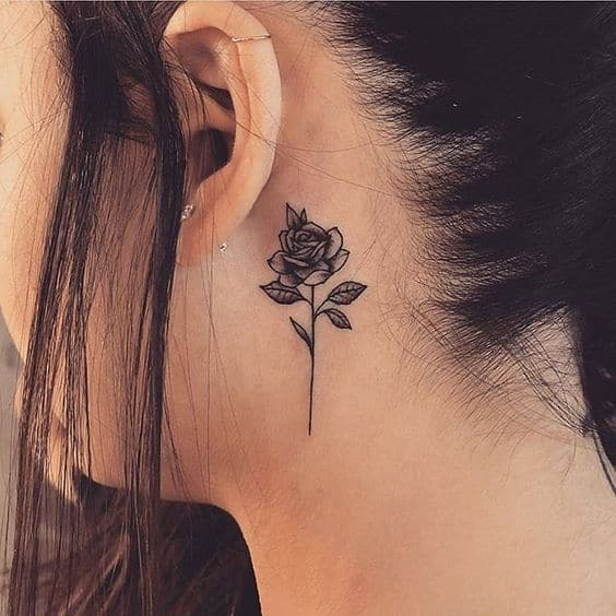 flowers behind ear tattoo roses.