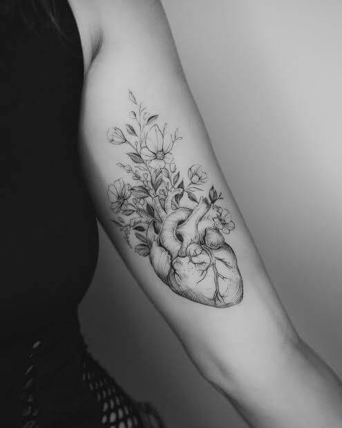 heart with flowers tattoo.