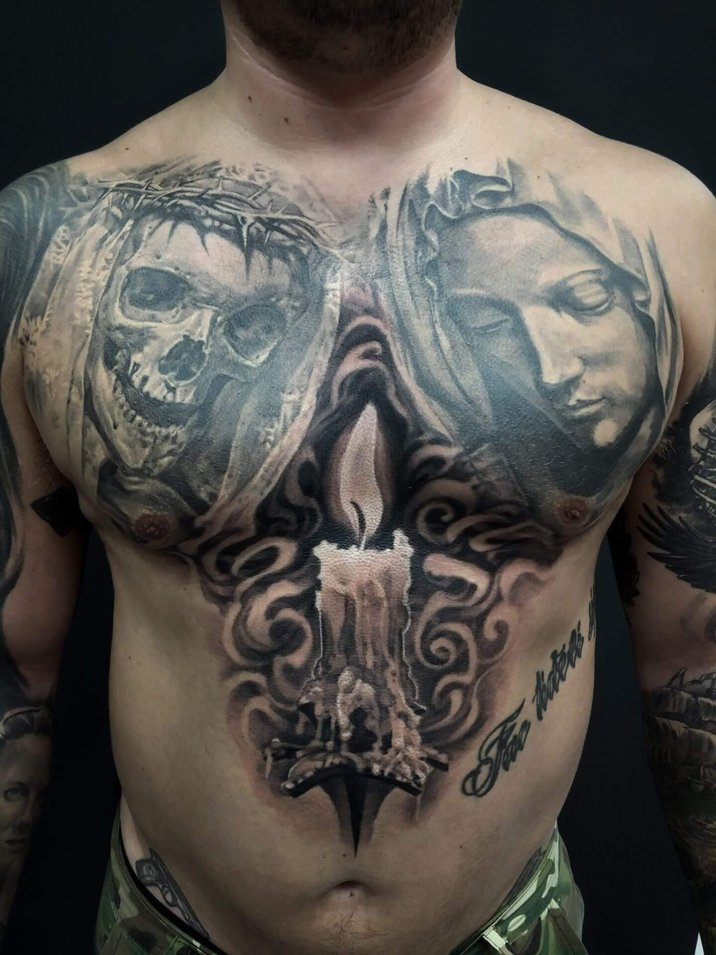 religous tattoo chest.